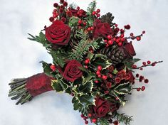 This one is for leith. She loves this  with white and red roses  2 white rose to every 1 red. Ok not to use holly. Use another shiny dark green leaf. Have the two bouquets compliment each other.