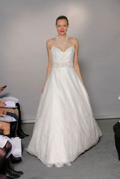 Sleeveless A-line with empire waist organza over satin elegant bridal gown
