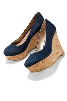 We posted these 6 months ago, but as Kate wore herCorkswoons this week (Oct. 18 2013) & because they're now on sale, here are the Pump cork wedges at Boston Proper