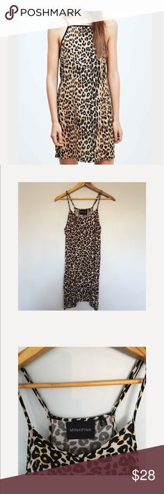 MINKPINK Tiger Print Cross Back Dress SZ S MINKPINK Tiger Print Cross Back Dress SZ S. Perfect condition. No flaws. First picture on model is slightly different but is being used for styling inspiration purposes. MINKPINK Dresses Mini