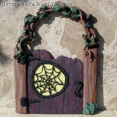 Fairy gate with vine arbor and glow in the dark spider web window.