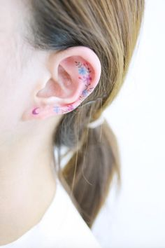 Floral ear tattoo by Banul