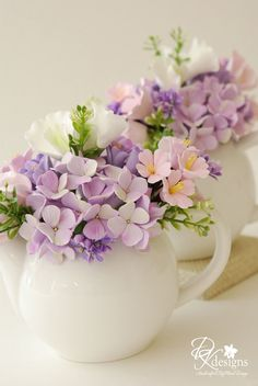 Teapots with Flowers in Them - Bridal Shower Tea Centerpieces. Lovely