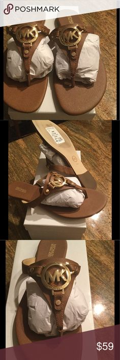 NWT MICHAEL KORS MEDALLION THRONG SANDAL 9.5M Women's 'gold logo medallion' thong flat sandals with textured tan like leather uppers from MICHAEL MICHAEL KORS. The flat sandals are constructed with a round toe post, cushioned ... Michael Kors Shoes Flats & Loafers