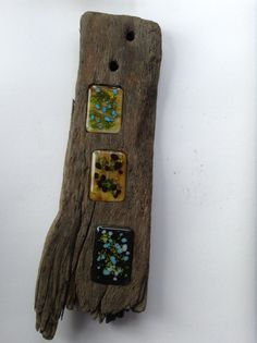 Three fused glass rectangles with coloured frit set in found driftwood from Bexhilll beach.