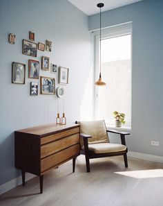 A touch of nostalgia marks the upstairs home office, furnished with several vintage pieces: a teak Danish dresser, a Hans Wegner armchair, and Jo Hammerborg's 1962 Orient pendant, made from a copper shade with rosewood detailing.
