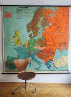 1950s' large colourful map of Europe. Combine it with furniture of the same era. Or don't. Hang it upside down to create an abstract piece of graphic design or make a political statement. The possibilities seem endless ;)