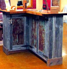 Reclaimed barn wood bar. Bar top made from an 1860's barn and the sides are from an 1880's barn. Courtesy Allens Custom Woodworking and Design.