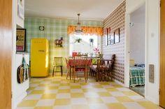Pretty kitchen. Love the yellow fridge!