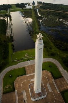 Aerial view of the San Jacinto Monument .  At the very top of the picture (above the star) the Battleship Texas can be seen.