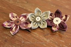 Fabric flower tutorial. I just love these. I'm going to make one tonight. So many different uses that I can think of :)
