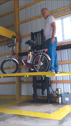 Garage storage lift hubby needs this music heros more diy forklift elevator for the shop or barn solutioingenieria Image collections