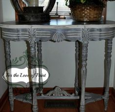 This carved hall table was painted by For the Love of Paint in Indiana.  Transformed using Smoke Signal and Navajo White, it's simply stunning!  Original post: 12 Days of Christmas – 7 more days! — American Paint Company