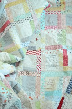 I would love to make a quilt that our baby shower guests could sign. If I'm still quilting and have the time, I'll have to do this for our baby.