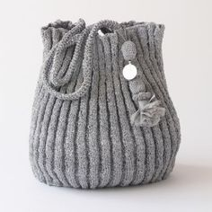 Made from recycled plastic bags. Designed by the French designer Domino Leserre and knitted by a womens co-operative in Morocco.