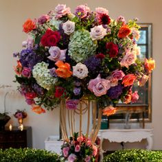 Extravagant, tall and colorful centerpiece | Robyn Rachel Photography | www.theknot.com