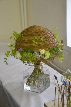 Flower arrangement with basket upside down   via Facebook
