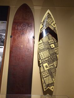 A Tom Blake redwood surfboard, 1931 and a George Downing surfboard, 1977. On exhibit in Change: 125 Years Through the Eyes of Bishop Museum.  http://www.bishopmuseum.org/exhibits/index.html