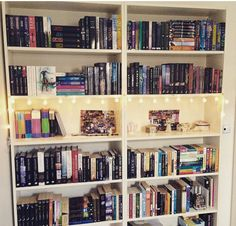 "amberthebooklion: "" I rearranged my shelves again… And added fairy lights!! """