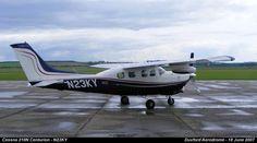 Cessna 210N Centurion - N23KY by graham.wood.14661