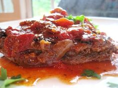Old fashioned swiss steak.You may add celery to the sauce and carrots the last hour and sliced mushrooms the last hour.served with mashed potatoes and homemade cornbread. Swiss Steak Recipes, Cube Steak Recipes, Pork Recipes, Cooking Recipes, Crockpot Recipes, Oven Swiss Steak, Steak Dinners, Bison Recipes, Gourmet