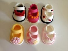 Fondant & Gum Paste baby shoes from CakeCentral.com