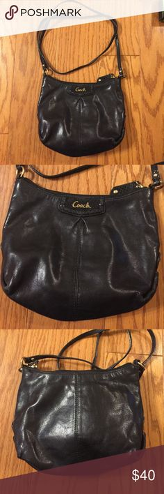 """Coach Mini Crossbody Small black crossbody with snakeskin like detailing on straps and behind logo. Zippered closure with side pocket and zip pocket on the inside. Measures 9""""w x 8""""h Coach Bags Crossbody Bags"""
