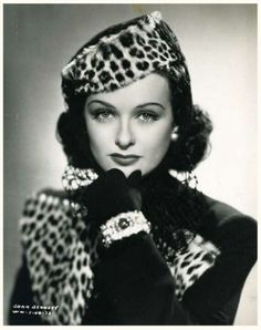"joan bennett | Joan Bennett sports a leopard print hat and matching jacket. || Was known for movies and working with directors like Fritz Lang before she made her appearance on the cult classic soap ""Dark Shadows""."