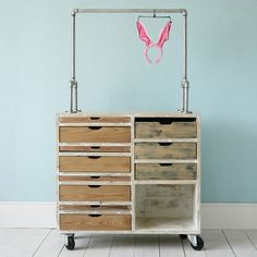 Movable clothing racks to reduce clutter and consolidate closets. OLIVIA Dresser by xo-inmyroom