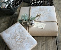 Cute idea for your Christmas wrapping -brown paper with holiday stencil patterns sprayed on.