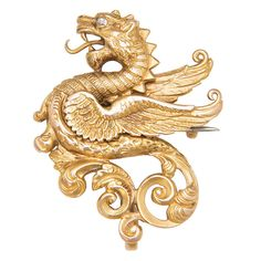 Very Detailed,Circa 1890 Griffin Brooch, 14K yellow Gold with a Diamond eye and a hook on the back for hanging a Locket or Pendant watch.