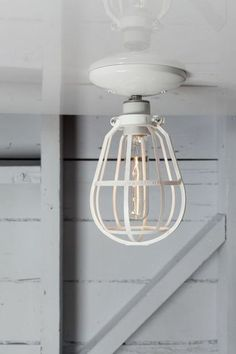 Canopy Cage Lighting on Uncovet - This industrial cage light brings edge and excitement to a room's decor.