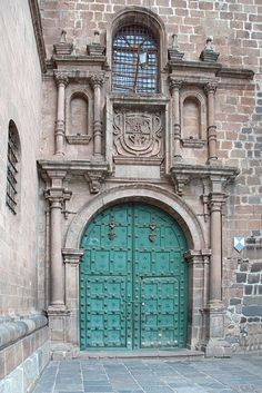Spanish colonial doorway in Peru. I think I would LOVE a door this color and paint the house the gray color.