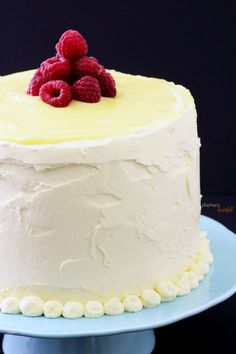 Lemon Cake with fresh raspberries and topped with lemon curd.  from #DietersDownfall.com