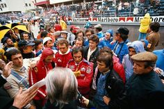 Pre-race drivers' briefing. You can see a number of familiar faces there. Race won by Niki Lauda (Scuderia Ferrari), followed by Emerson Fittipaldi (Marlboro Team McLaren) and Carlos Pace (Martini Racing). 1975 Monaco Grand Prix, Circuit de Monaco © Schlegelmilch Photography