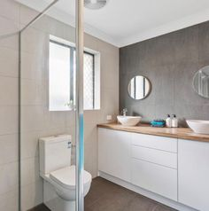 Flashback to when @renovationfamily used our hickory maple benchtop and gloss white push to open doors in the modern profile to create this sleek and stylish bathroom design! . . . #kaboodle #kaboodlekitchen #kaboodlebathroom #kaboodleforeveryroom #bathroomdesign #bathroominspo #diybathroom