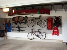 Garage Storage Systems for Neat and Tidy Garage: Mountain Bicycle White Wall Red. Garage Storage Systems for Neat and Tidy Garage: Mountain Bicycle White Wall Red Cano Cement Floor
