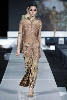 A model showcases designs on the runway by Yasra during the Yasra Kebaya show on the first day of Jakarta Fashion Week 2010 at Pacific Place on November 7, 2010 in Jakarta, Indonesia.