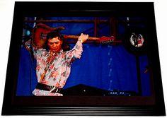 stevie ray vaughan playing fender stratocaster   1000x1000.jpg