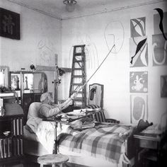 Henri Matisse drawing a head for the decoration of Chapelle du Rosaire in Vence in his room in the Hotel Regina, Nice-Cimiez, 1950