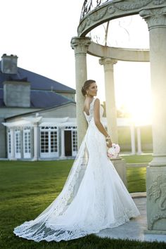 Stunning wedding gown with straps and lace overlay!  Beautiful!