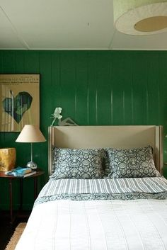 A very green bedroom. Color is good for you!