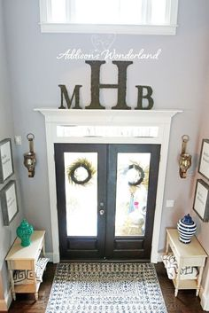 Add a shelf above the door to break up the large wall for Large foyer wall decorating ideas