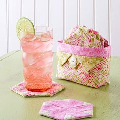 Raise your glass to salute a sweet set of pieced coasters in a charming  fabric caddy.