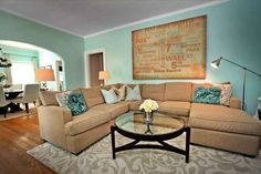 teal and tan living room | Teal and tan living room. Looks comfortable and ... | New House Ideas