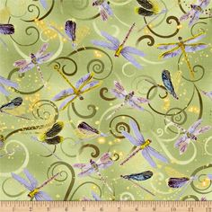 Kanvas Dance Of The Dragonfly Metallic Dancing Dragonflies Celedon from @fabricdotcom Designed by Maria Kalinowski for Kanvas in association with Benartex, this cotton print collection features metallic gold accents. Colors include green, purple, blue, and metallic gold accents.