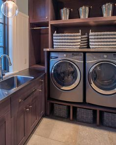 I like the masculine tones of the room.. A nice laundry room for sure