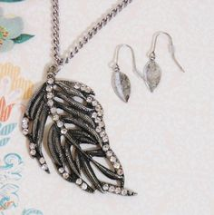 Antiqued pewter/silver tone rhinestone leaf necklace & earrings set.