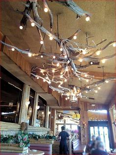 Interesting Driftwood Lighting Fixtures on porch