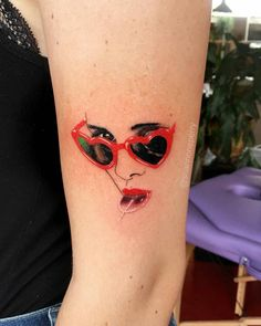 Stanley Kubrick's Lolita inspired tattoo on the upper arm